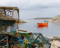 Lobster traps and boat at Peggy's Cove, Nova Scotia